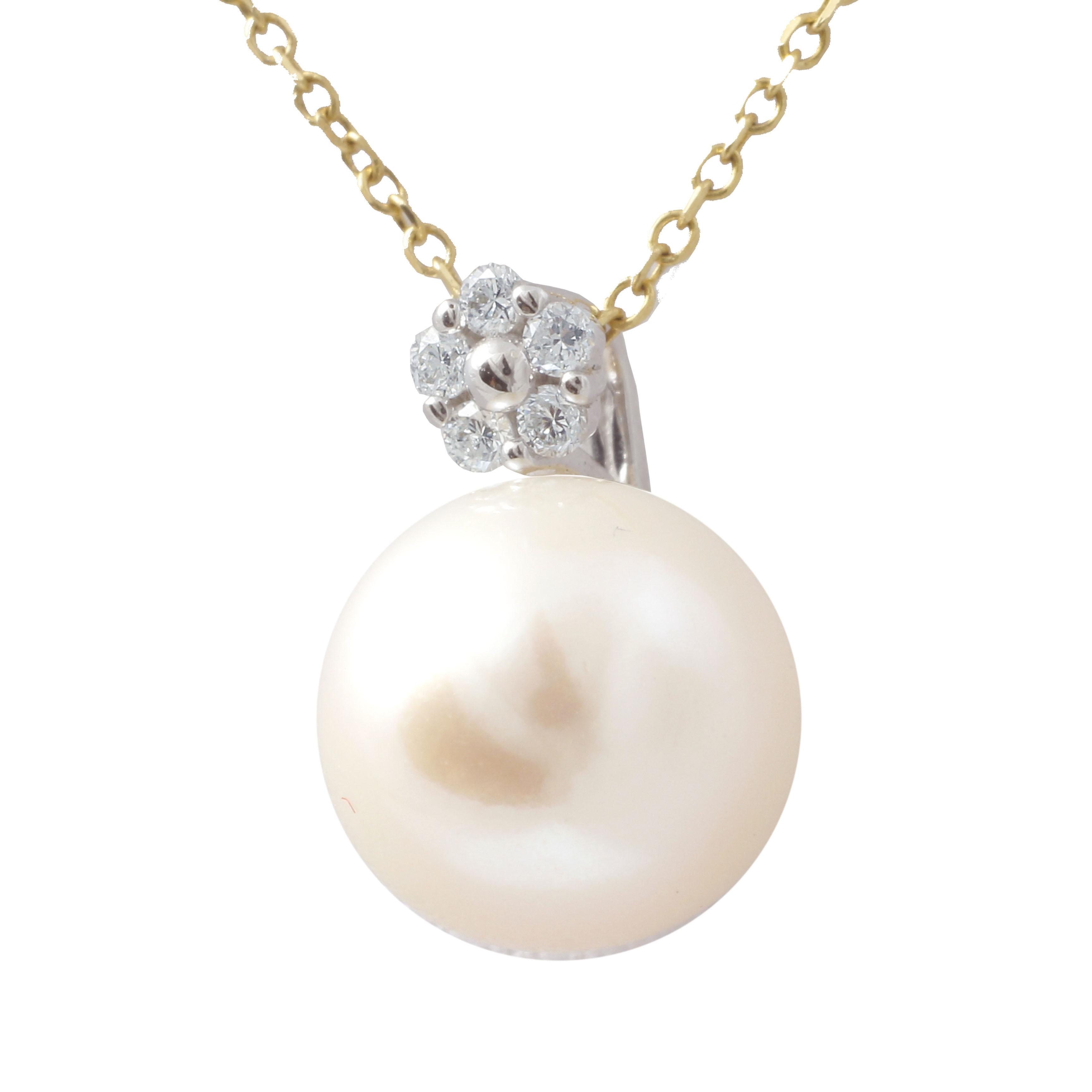 Wisiorek złoty z brylantami i perłą